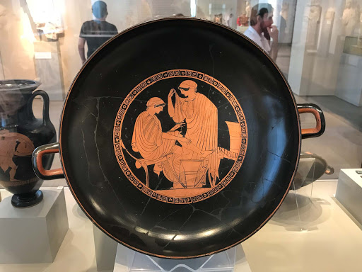 Bowl-women-carding-wool.jpg - This ancient bowl depicts women carding wool in Italy, circa 470-480 B.C.