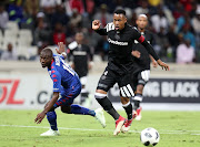 Happy Jele of Orlando Pirates shields ball from Aubrey Modiba of Supersport United during the Absa Premiership 2017/18 match between Supersport United and Orlando Pirates at Mbombela Stadium, Johannesburg on 11 April 2018.