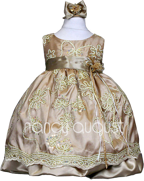 Photo: Gleaming Gold Baby Dress with Gold Embroidery and Sparkles: This deliciously unique gold baby dress is all about glam and fabulousness. It boasts a light weight fabric with a gold chain like embroidery throughout accented with hand sewn sequin sparkles. This baby dress also features a sleeveless design, a detachable floral bouquet on the waistline, and a crinoline enhanced skirt for extra fullness. To top things off, this little girly outfit comes with a matching headband and bloomer for your baby girl. Perfect for any occasion such as a wedding ceremony and holiday or birthday party. We are positive this classy baby dress will take your breath away.