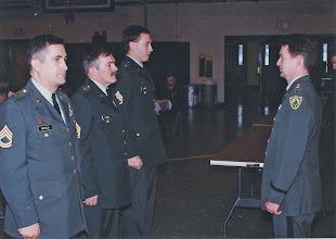 Photo: Commander Steve Spearin and SFC Dave Nichols, SFC Ken Glidden, and SSG Tim Hebert, at the Bennett Dr. Armory in Caribou.  Probably 1999.