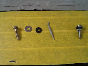 Photo: Fastener system... #12 pan head screw + stainless steel washer + neoprene washer + butyl tape.