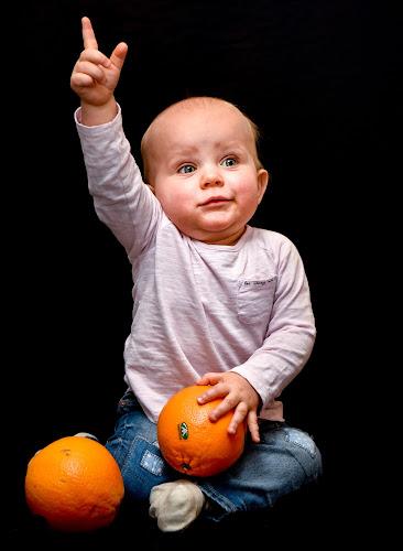 Julienne with oranges by Mats Andersson - Babies & Children Child Portraits ( orange, body language, children, oranges, attention )