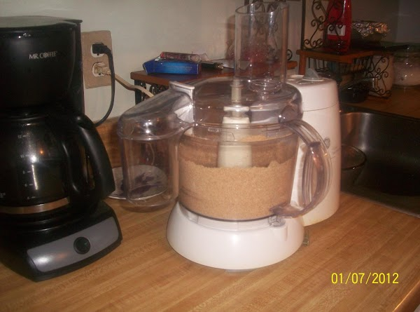 In a food processor, grind the biscotti until fine.Add the melted butter and process...