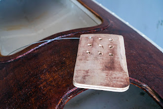 Photo: the skeg, with control wire attached, holes to cast lead in