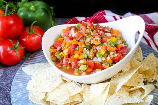 A Bowl Of Garden Fresh Salsa With Tortilla Chips.