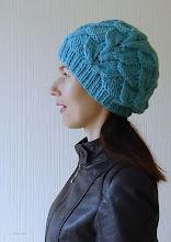 Photo: женская вязаная шапка с косами Атлантика