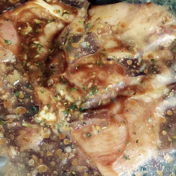 Pour marinade into a gallon size Ziploc style bag. Place sliced breasts inside bag...