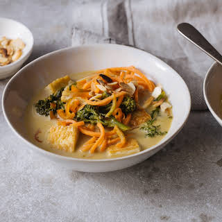 Malaysian Tofu & Carrot Noodle Laksa With Flaked Almonds.