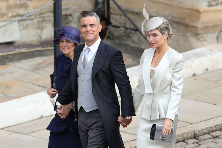 Gwen Field, Robbie Williams and Ayda Field arrive ahead of the wedding of Princess Eugenie of York and Mr. Jack Brooksbank at St. George's Chapel in Windsor, England.