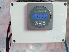 Photo: The Victron BMV-700 Battery Monitor mounted on its box, with the shunt installed inside.