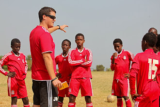 Photo: Coach McKinstry with elite young players at the Craig Bellamy Academy (Photo: Laura Cook).