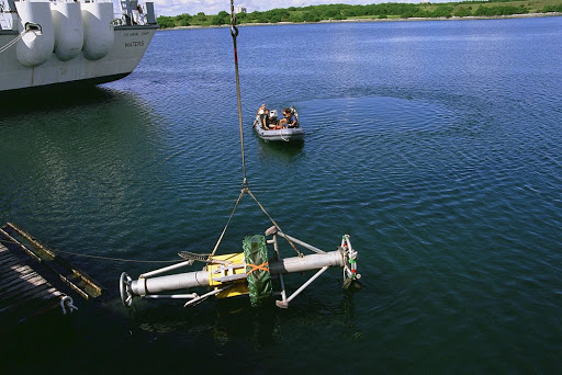 A Diver Operated Plug DOP is lowered into the water during a test of the unmanned robotic submersible recovery system known as Max Rover.