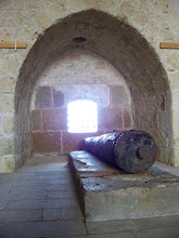 Photo: A rusty, old cannon in those tunnels in the walls around the castle, facing out to sea.
