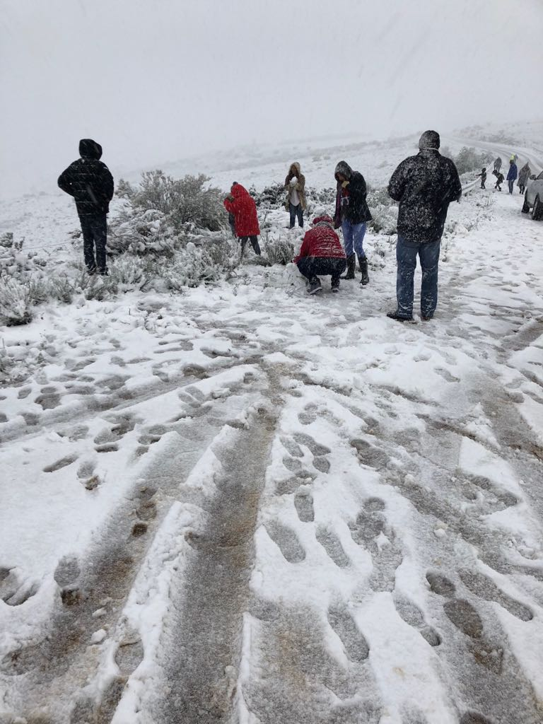 Children play in the snow about 10 km outside Ceres, on the way to Matroosberg.