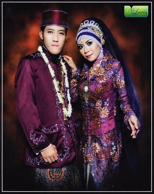 Rias pengantin dengan hijab dan kebaya ungu