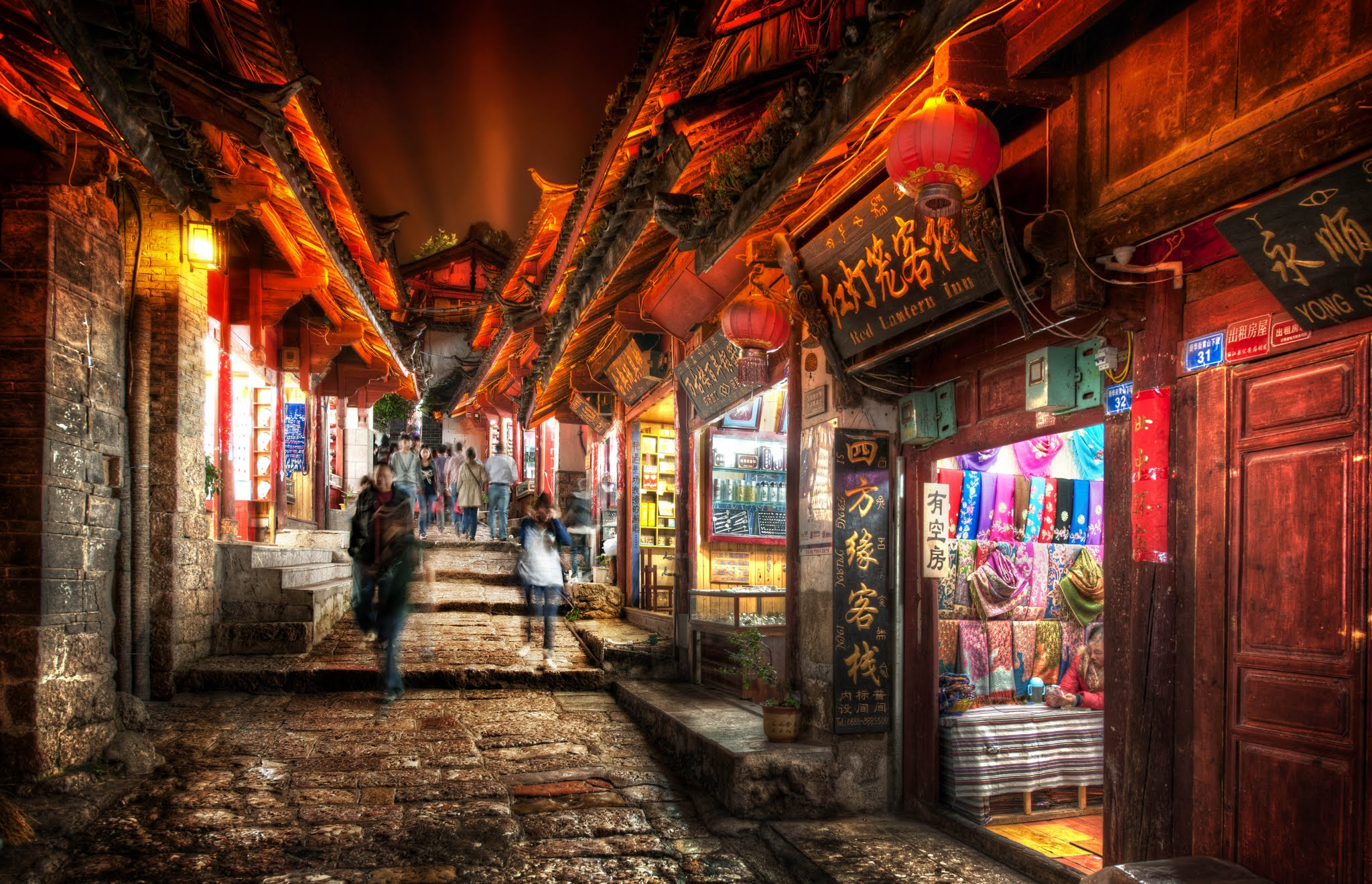 Photo: Entering the Little Streets of Li Jiang (shared first to Google+ !)   I'm just now getting into Li Jiang and I'm having a great time exploring this place with +Tom Anderson. We've been taking our cameras all over creation, day and night. It's been very busy, but we're finally getting some downtime to process photos. I picked this one I just took a few hours ago and showed him how I did it (kind of my like an in-person version of my HDR Tutorial... it is free and fun... see it at http://www.StuckInCustoms.com/hdr-tutorial/ ).   We've got a couple rooms at a beautiful place here called Banyan Tree. They have a few different resorts all over the world...very nice... (no they didn't pay me or give me free rooms.... I feel kinda like I always have to say this) Anyway, I recommend them because there are tons of good photo ops just around the resort itself.   We're currently sitting here in the little library... he's just installed Lightroom and we're going through a few workflow things while we both edit photos... getting ready for another outing... having a good time.  #SICInDatabase