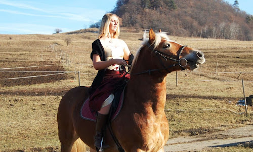 Wearing a dress and riding a horse in Romania