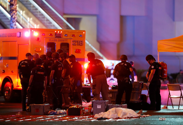 A body is covered with a sheet in the intersection of Tropicana Avenue and Las Vegas Boulevard South after a mass shooting at a music festival on the Las Vegas Strip in Las Vegas, Nevada, U.S. October 1, 2017.