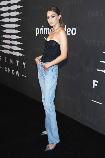 Description: Gigi Hadid in a bustier and jeans