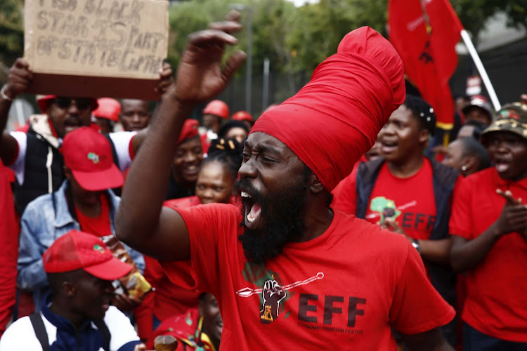 Members of the EFF protest in Parktown, Johannesburg, on the second day of Pravin Gordhan's testimony at the Zondo commission of inquiry on November 20 2018.
