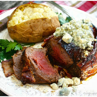 Grilled Bacon Wrapped Beef Tenderloins with Garlic & Herb Blue Cheese Butter.