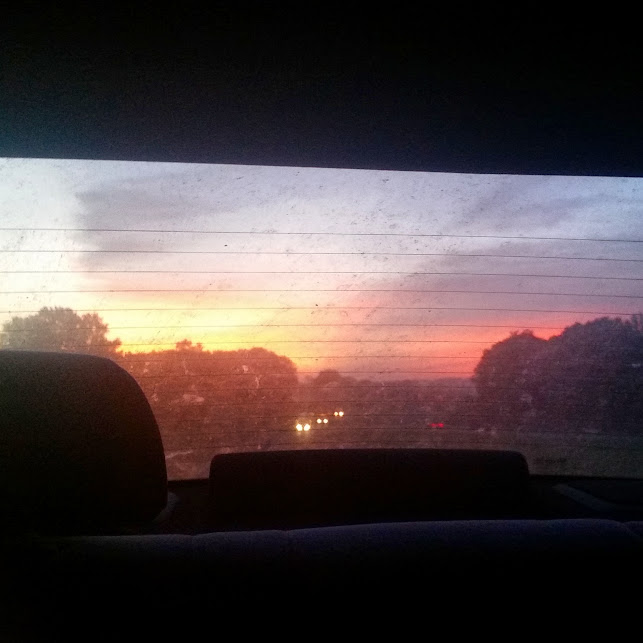 sunrise in the rearview