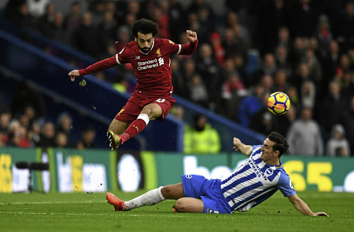 Air apparent: Liverpool's in-form Mohamed Salah, left, skips over Lewis Dunk of Brighton on Saturday. Salah has grabbed a lot of attention this season, though his teammates are not far behind as revved-up Liverpool prepare to host Spartak Moscow on Wednesday. Picture: REUTERS