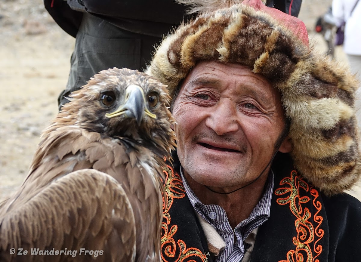 Mongolia. Golden Eagle Festival Olgii. Contest and his eagle during the Golden Eagle Festival