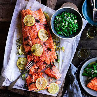 Slow-cooked ocean trout with peas, and Meyer lemon and fennel salsa.