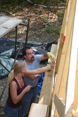Justin and Asten put up the very first board of sheathing!