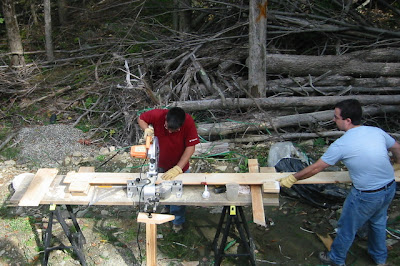 The Hammer Brothers at work with the chop saw
