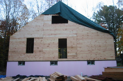 Sheathing up to the collar ties on the back of the house