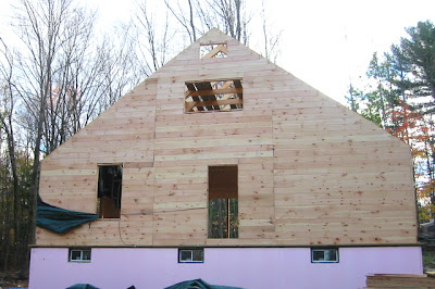Sheathing the North wall is done too, except that very top window