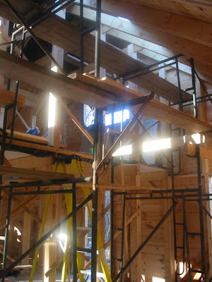 Looking toward the back kitchen door, with scaffold in sunlight, and the natural skylight.