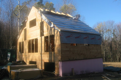 Up the back of the house with sheathing, wrap, foam and strapping.