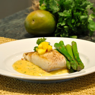 Pan Seared Halibut with Mango and Cilantro Buerre Blanc Sauce.