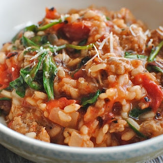 Oven Baked Risotto with Sausages and Tomatoes.