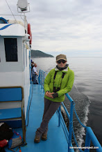 Photo: Liz inclines on the rail fo the Shark, crossing the Baikal on the 4th of July