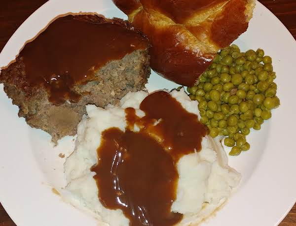 Tomato-free Meatloaf With Mashed Potatoes, Beef Gravy, Buttered Peas, And Warm Bread.