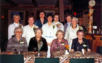 Photo: 50 jarig bestaan 1981 Bestuur v.l.n.r. Willie Lieffering, Antje Witting, Jantje Vedder, Coby Kamping, Marchie Vedder, Zus Vedder en Aaltje Udding. Voor de vier oudste leden vanaf oprichting: mevr. Kluiving, Lanjouw, Braams en Stokker