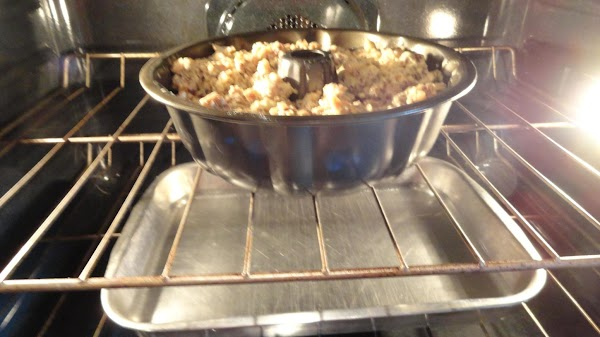 Place a pan of water on the rack below the bunt pan to keep...