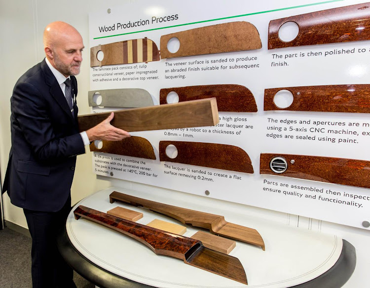 Bentley customer host, Nigel Lofkin, explains the wood veneer production process, at Bentley's operation in Crewe, England. Picture: BENTLEY/NICK ENGLAND