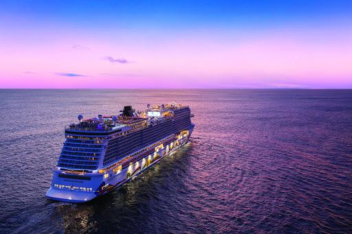 Norwegian Encore sailing in Caribbean waters at twilight.
