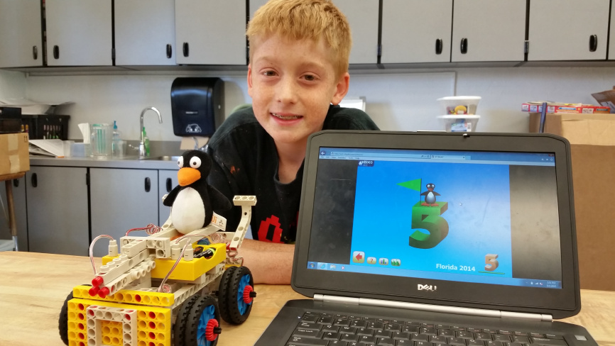 Math Master Austin Brown with JiJi and STEM tank