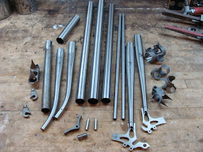 Photo: All the raw materials, I've got the chainstays slotted up and prepped for brazing in the rear dropouts and I've raked out the fork blades.