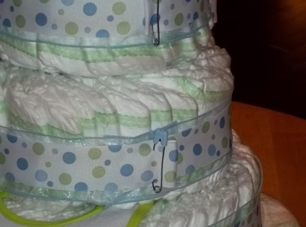 using three mixing bowls, sm, med, & lg. arrange the diapers in a pinweel...