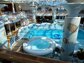 Photo: The Conservatory, further aft on the Lido deck, is an enclosed pool with 1 operating hot tub (at least it had bubbles in it.)  The roof appeared to be of the retractable kind but never did.  I spent several afternoons reading/napping in a lounger here.