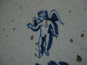Photo: Wall tile detail. Not the cutest of cherubs/angels. :)