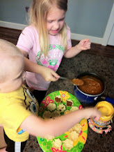 Photo: The kids worked together to add the Chili and Tostitos Queso into the Tostitos Scoops.