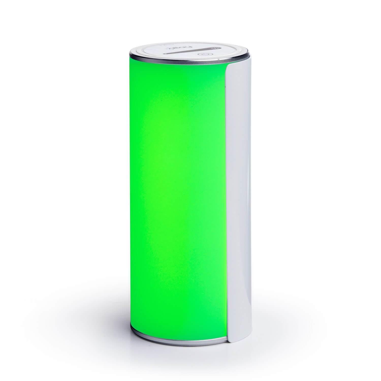 Photo of the Allay Lamp emitting bright green light